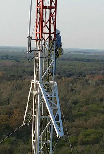 Elite Technician Jacob climbs a tower in Normangee, TX