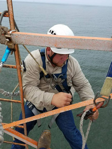 Elite Technician Travis installs pulley on a tower offshore